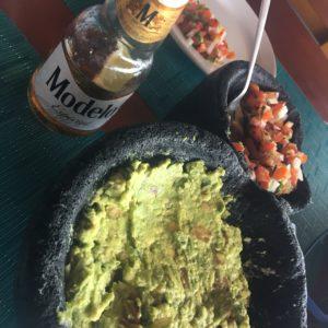 Salsa, guacamole and Modelo